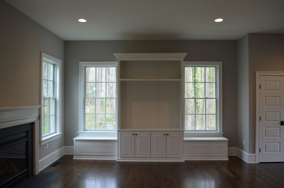 Benjamin Moore Smoke for a Traditional Family Room with a Built in Storage and Great Room   Family Room Built in by Lqdesign Studio