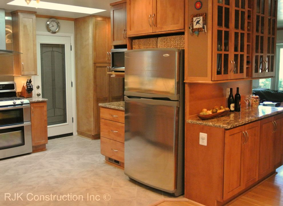 Bertch for a Traditional Kitchen with a Stainless Steel Sink and Bertch Kitchen with Sunroom by Rjk Construction Inc