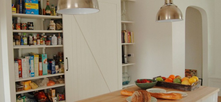 Better Built Barns for a Farmhouse Kitchen with a White and Pantry with Barn Door by Rebekah Zaveloff | KitchenLab