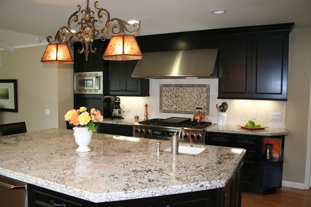 Bianco Antico Granite for a Traditional Kitchen with a Island Sink and Vannini by Kitchens of Diablo