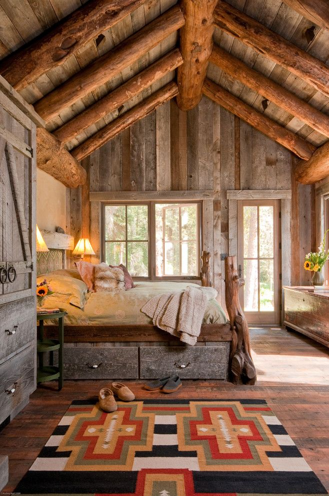 Big Sky Brokers for a Rustic Bedroom with a Exposed Timbers and Headwaters Camp Cabin, Big Sky, Montana by Dan Joseph Architects, Llc