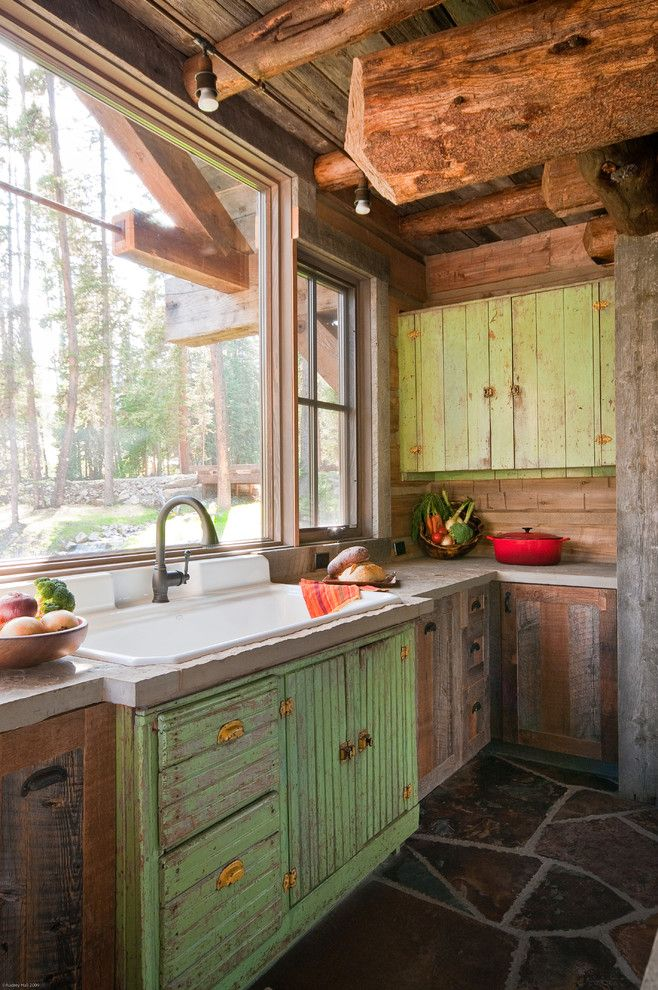 Big Sky Brokers for a Rustic Kitchen with a Rustic Wood and Headwaters Camp Cabin, Big Sky, Montana by Dan Joseph Architects, Llc