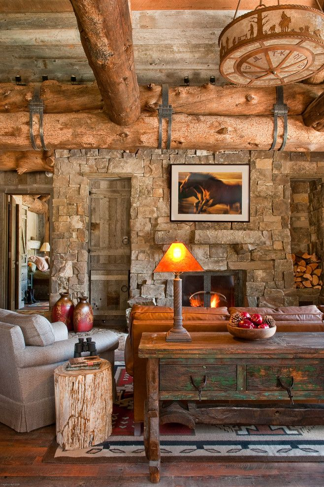 Big Sky Brokers for a Rustic Living Room with a Wood Bowl and Headwaters Camp Cabin, Big Sky Montana by Dan Joseph Architects, Llc