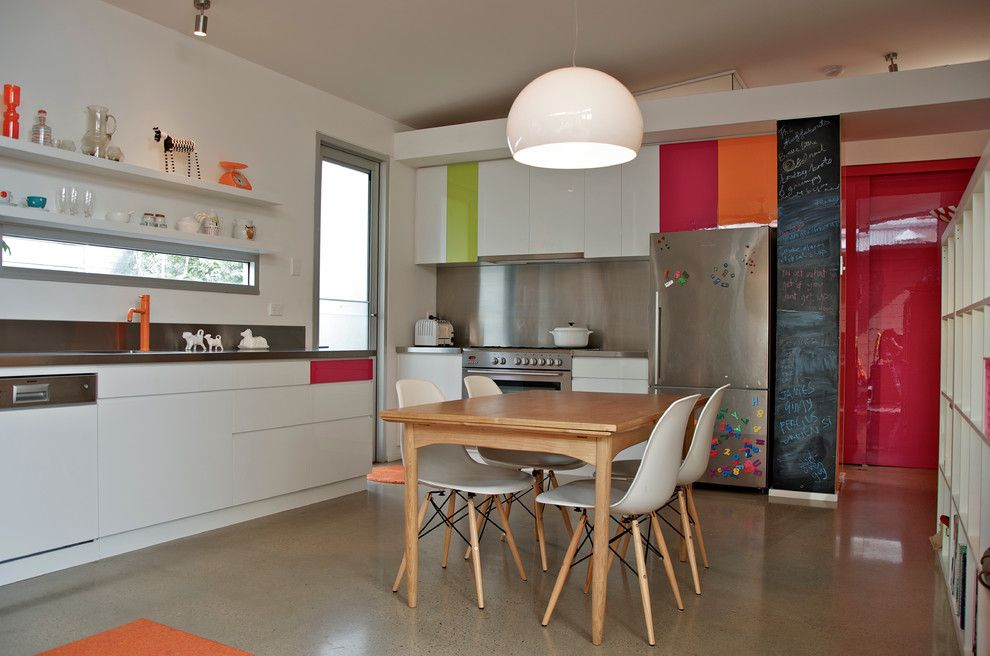 Bill Smith Appliances for a Eclectic Kitchen with a Light Wood Dining Table and Colorful Kitchen by Jeni Lee