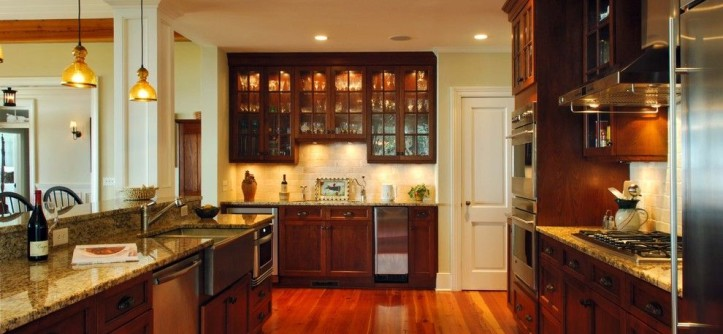 Bill Smith Appliances for a Traditional Kitchen with a Dark Stained Wood Cabinetry and Kitchen by Phillip W Smith General Contractor, Inc.