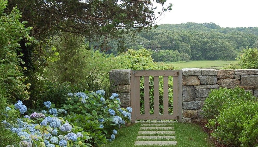 Billows Electric for a Traditional Landscape with a Cottage Garden and New England Fieldstone Wall and Gate on Cape Cod by Kimberly Mercurio Landscape Architecture
