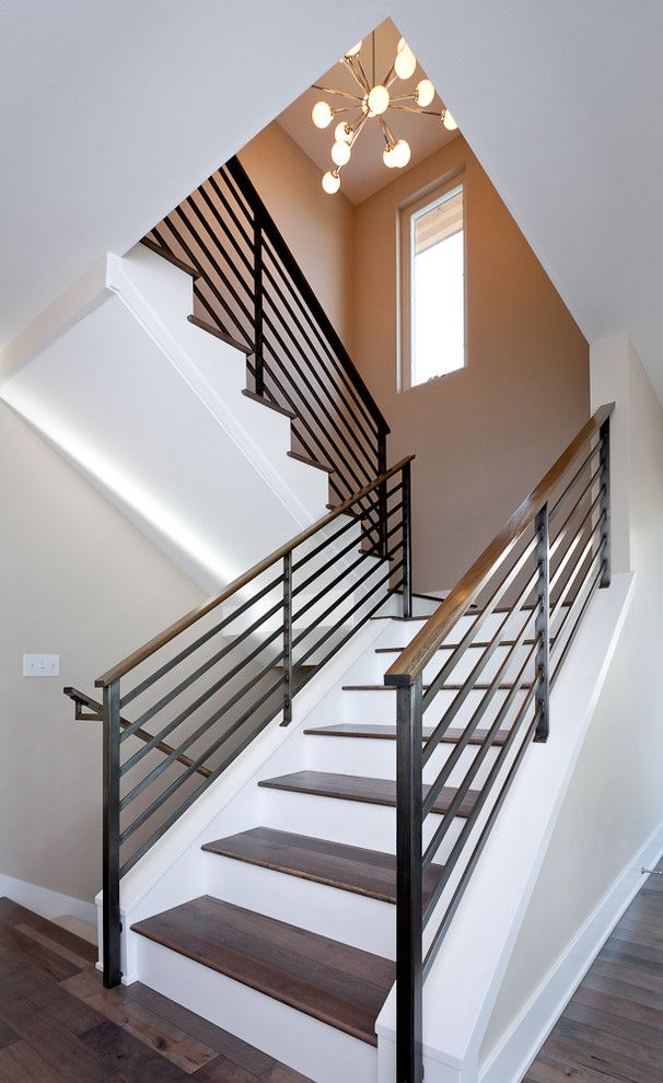 Blackened Steel for a Contemporary Staircase with a Dark Floor and Dyna   Mt Baker2 by Dyna Contracting