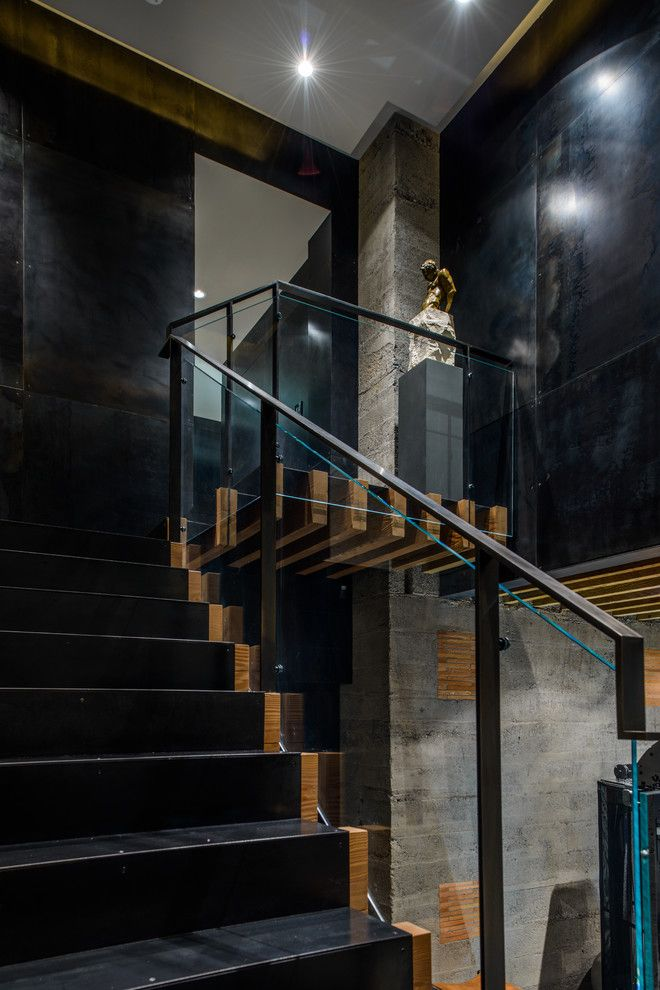 Blackened Steel for a Contemporary Staircase with a Glass Railing and Duchess Mansion by Garret Cord Werner Architects & Interior Designers