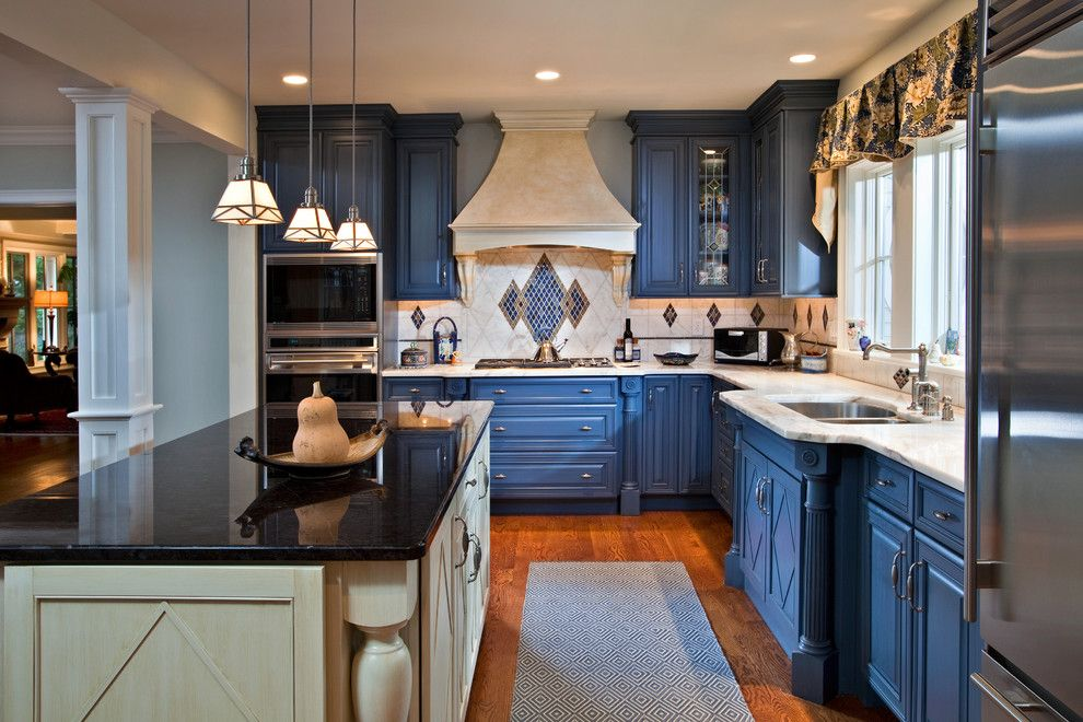 Blackened Steel for a Eclectic Kitchen with a Blue Cabinets and Colorful Kitchen in Saratoga Springs Ny by Teakwood Builders, Inc.