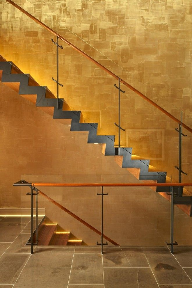 Blackened Steel for a Modern Staircase with a Stone Tile and Lake House Two   Stair by Mcclellan Architects