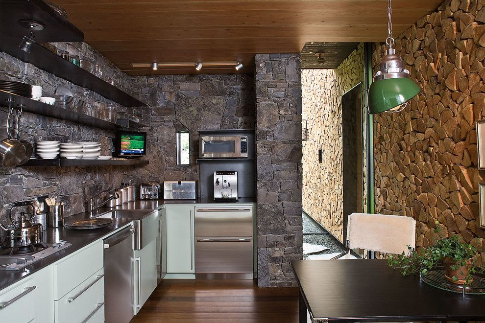 Blackened Steel for a Rustic Kitchen with a Barn and Stone Creek Camp by Andersson Wise Architects