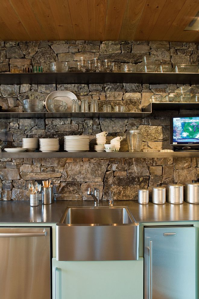 Blackened Steel for a Rustic Kitchen with a Water and Stone Creek Camp by Andersson Wise Architects
