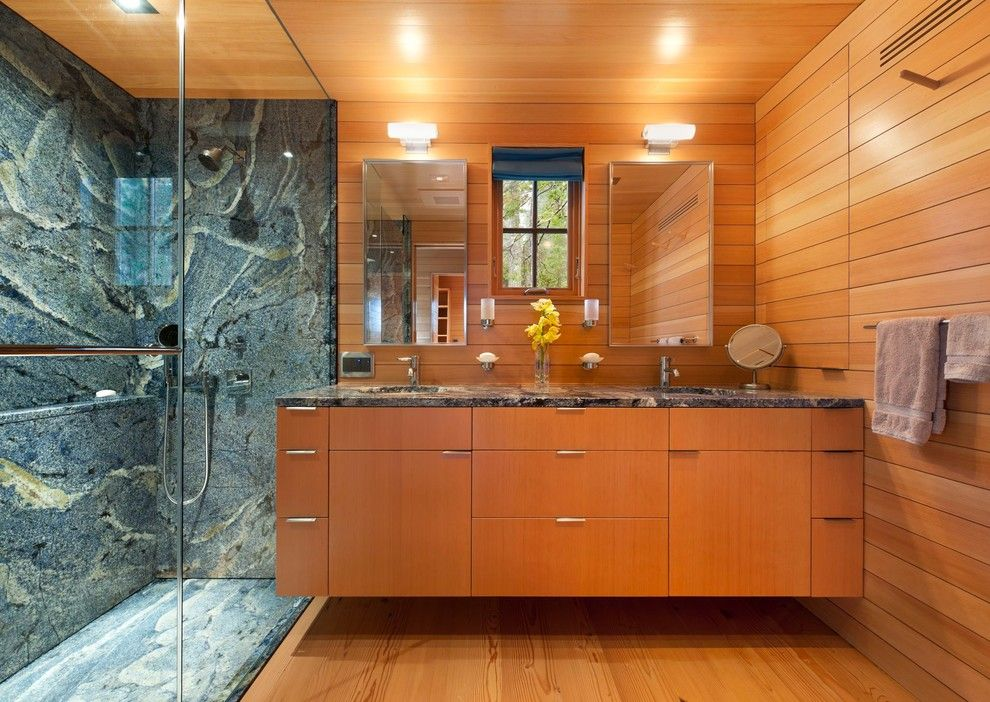 Blue Bahia Granite for a Contemporary Bathroom with a Wood Cabinet and Pond House by Elliott + Elliott Architecture