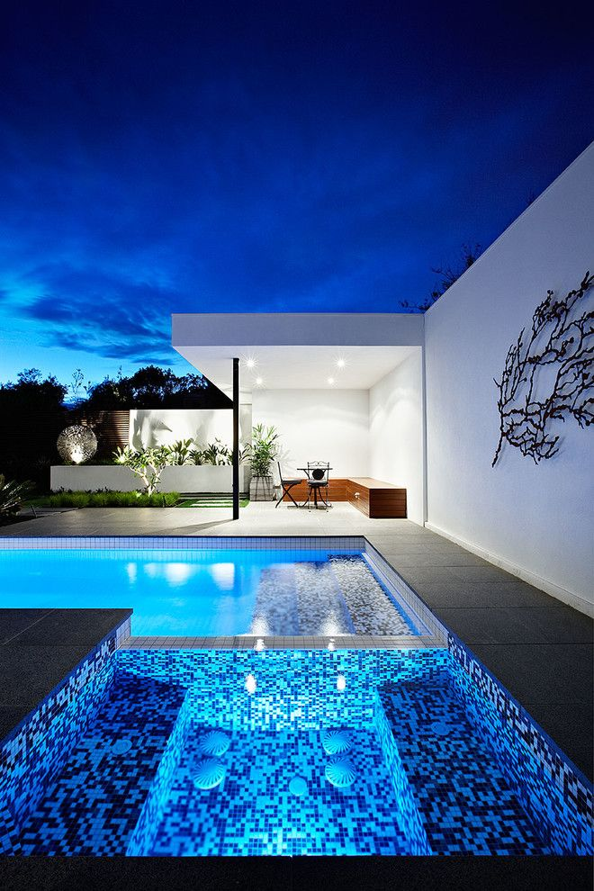 Blue Hawaiian Pools for a Contemporary Exterior with a Modern Backyard and Ddb Design Exteriors & Pools by Ddb Design Development & Building
