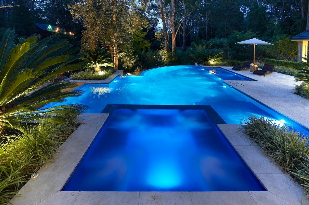 Blue Hawaiian Pools for a Contemporary Pool with a Umbrella and Hidden Valley by Dean Herald Rolling Stone Landscapes