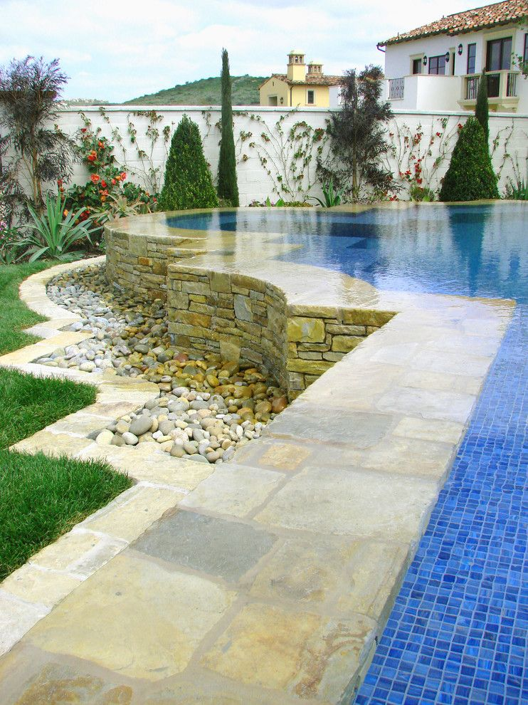 Blue Hawaiian Pools for a Mediterranean Pool with a River Rock and Ams Landscape Design Studios by Ams Landscape Design Studios, Inc.