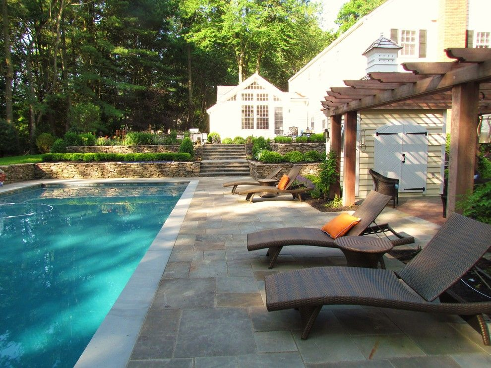 Blue Hawaiian Pools for a Traditional Landscape with a Wood Pergola and Timeless Elegance by Harmony Design Group