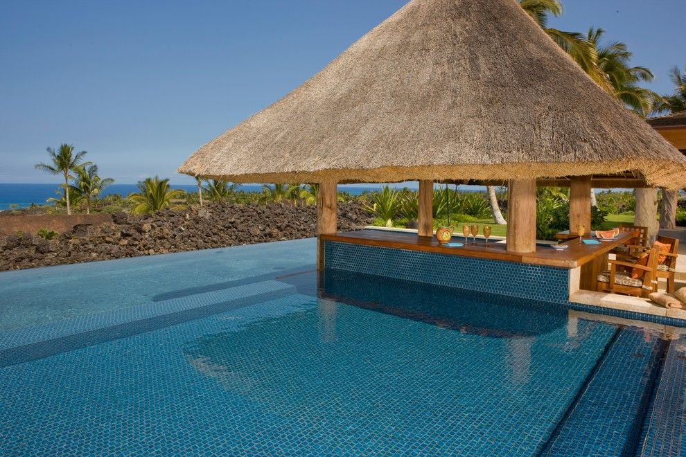 Blue Hawaiian Pools for a Tropical Pool with a Wood Post and Kona Coast by Saint Dizier Design
