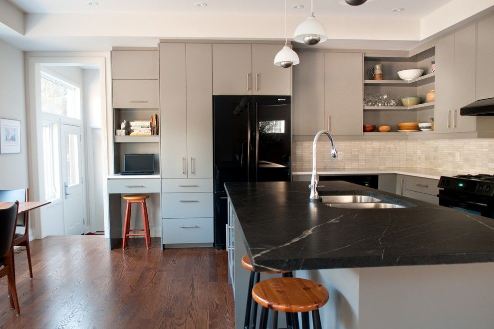 Bob Wallace Appliance for a Modern Kitchen with a Range Hood and Heather & Bob by Cabinetworks Plus