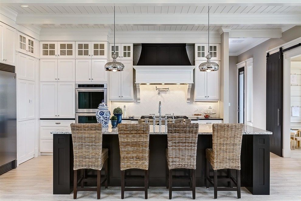 Boise Hunter Homes for a Traditional Kitchen with a Black Barn Door and 2014 Spring Parade of Homes Winner by Clark & Co Homes