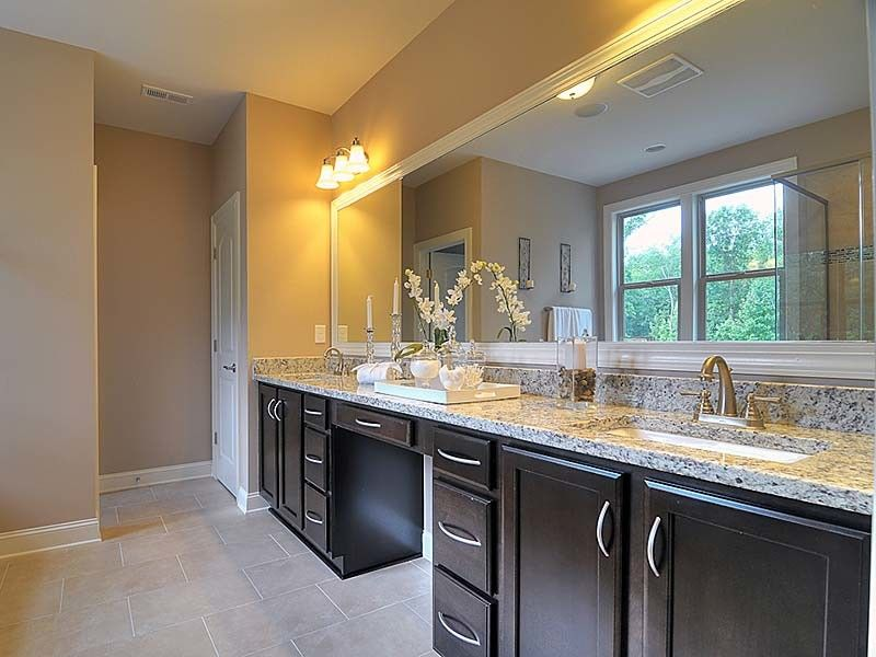 Bonterra Builders for a Traditional Bathroom with a Darkwood Cabinets and Interiors by Bonterra Builders