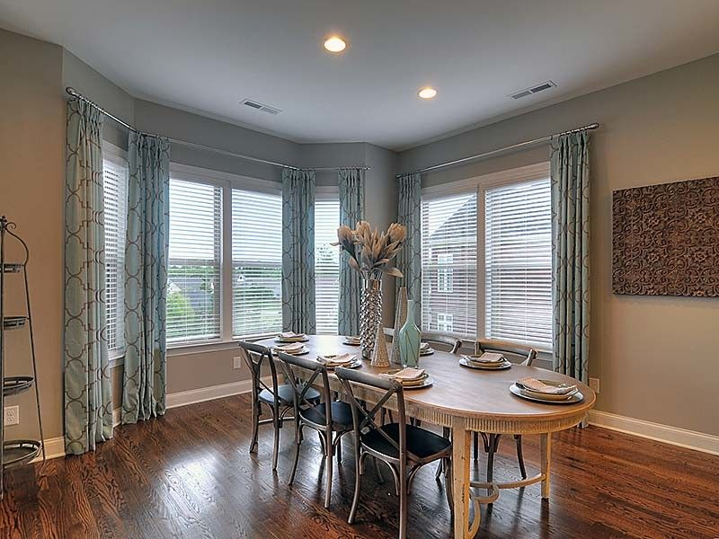 Bonterra Builders for a Traditional Dining Room with a Dining Room Table and Interiors by Bonterra Builders