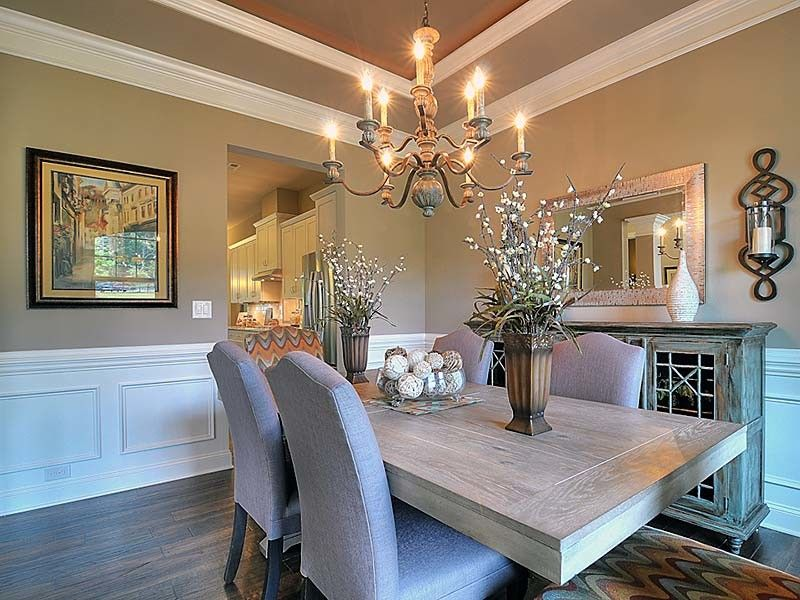 Bonterra Builders for a Traditional Dining Room with a Wood Table and Interiors by Bonterra Builders