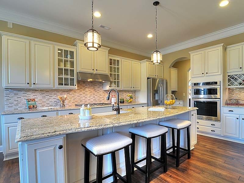Bonterra Builders for a Traditional Kitchen with a Island and Interiors by Bonterra Builders