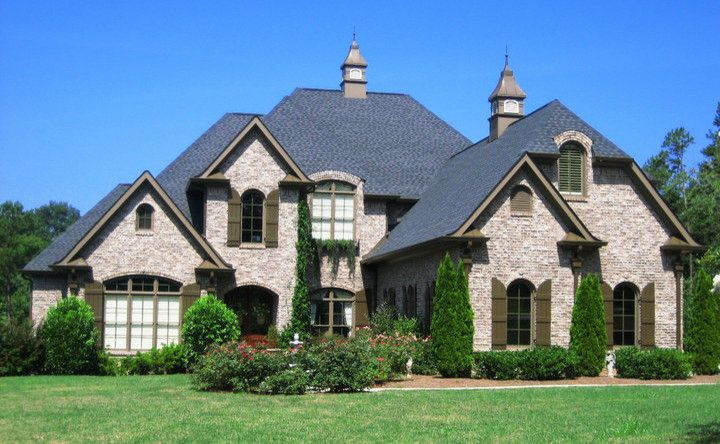 Boral Brick for a Traditional Exterior with a Exterior Shutters and Exterior by Whitmire Custom Homes