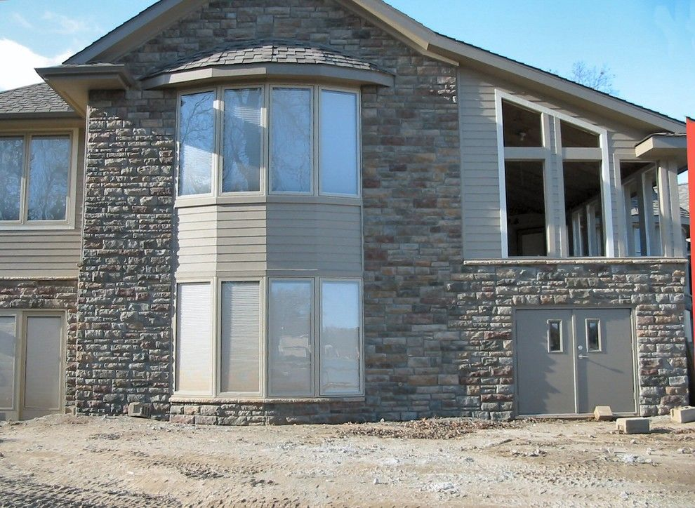 Boral Cultured Stone for a Traditional Exterior with a Cultured Stone and Boral Cultured Stone   Limestone by Brighton Stone & Fireplace, Inc.