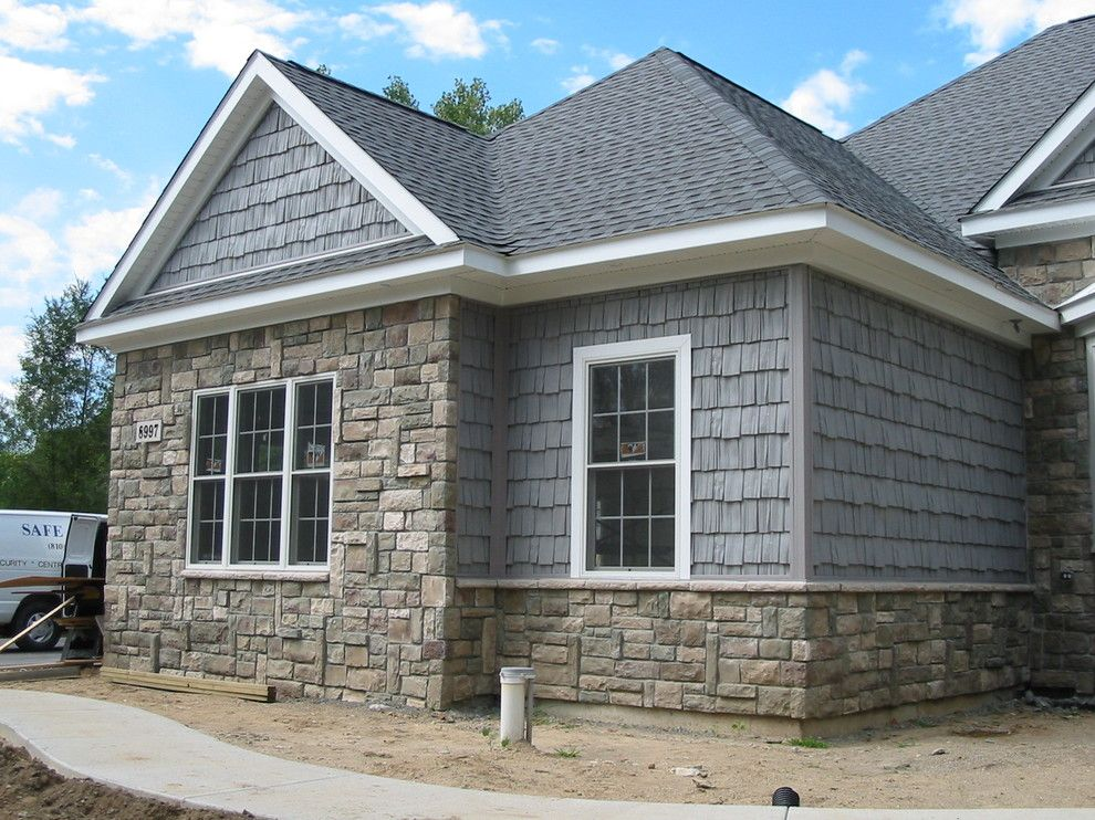 Boral Cultured Stone for a Traditional Exterior with a Shake Siding and Boral Cultured Stone   Cobblefield by Brighton Stone & Fireplace, Inc.