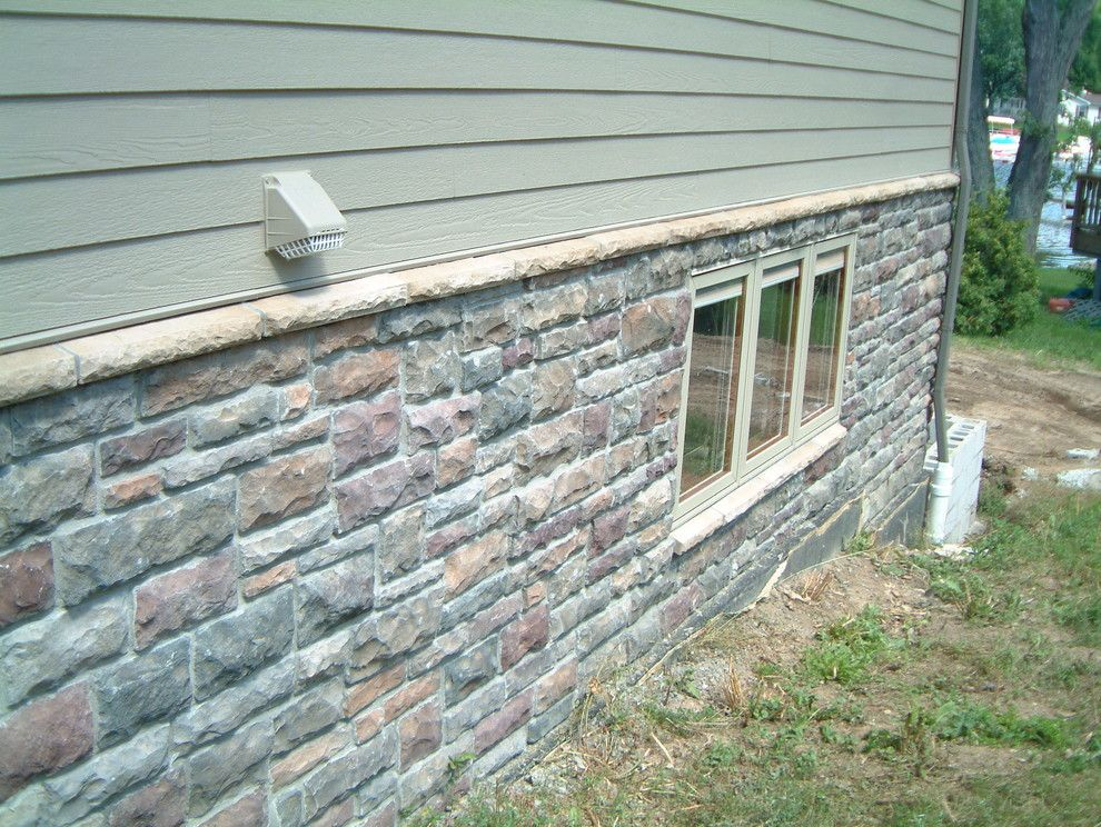 Boral Cultured Stone for a Traditional Exterior with a Thin Veneer and Boral Cultured Stone   Limestone by Brighton Stone & Fireplace, Inc.