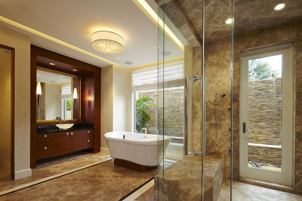Boyd Lighting for a Contemporary Bathroom with a Freestanding Bathtub and Arnold Schulman by Arnold Schulman Design Group