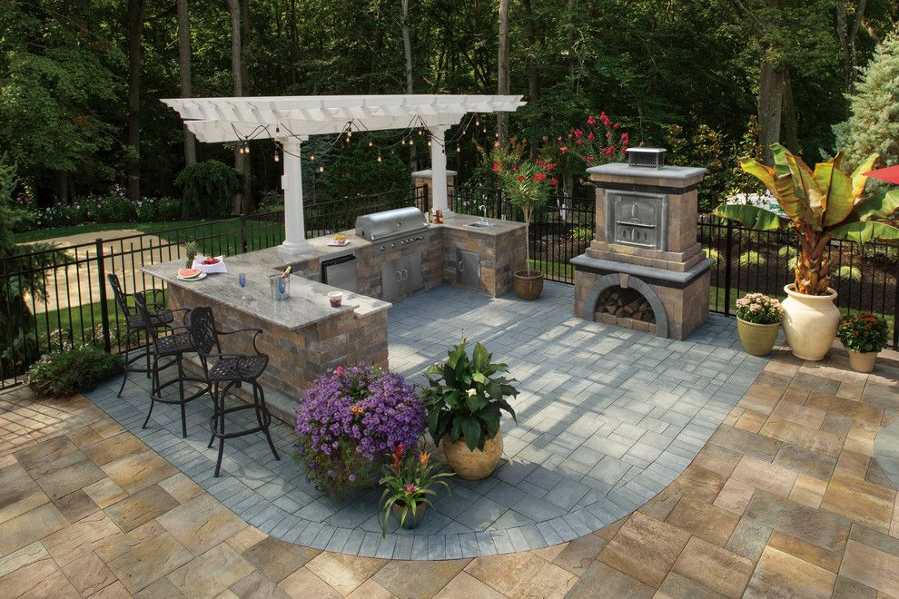 Brick Fireplace Makeover for a Contemporary Spaces with a Outdoor Fireplace and Cambridge Pavingstones with Armortec by Cambridge Pavingstones with Armortec