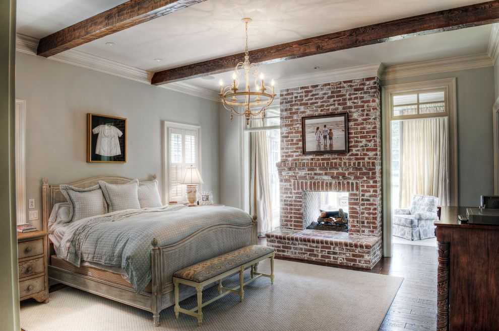 Brick Fireplace Makeover for a Traditional Bedroom with a Carved Wood and Gabriel Builders by Gabriel Builders Inc.