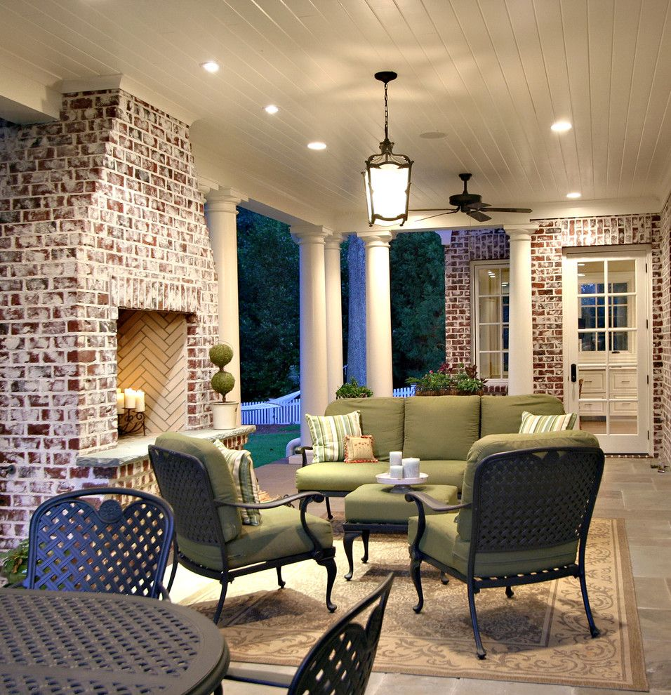 Brick Fireplace Makeover for a Traditional Porch with a Wood Ceiling and Back Porch by Dresser Homes