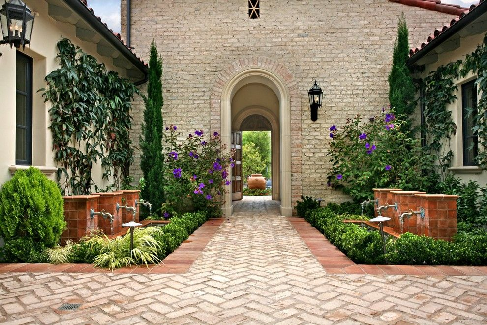 Brick Paver Patterns for a Mediterranean Landscape with a Centerpiece and Ams Landscape Design Studios by Ams Landscape Design Studios, Inc.