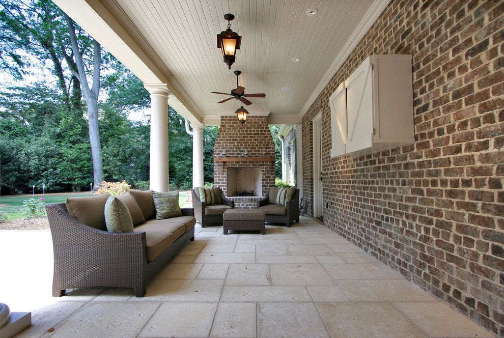Brick Paver Patterns for a Traditional Porch with a Brick Fireplace Surround and Rear Porch by Dresser Homes