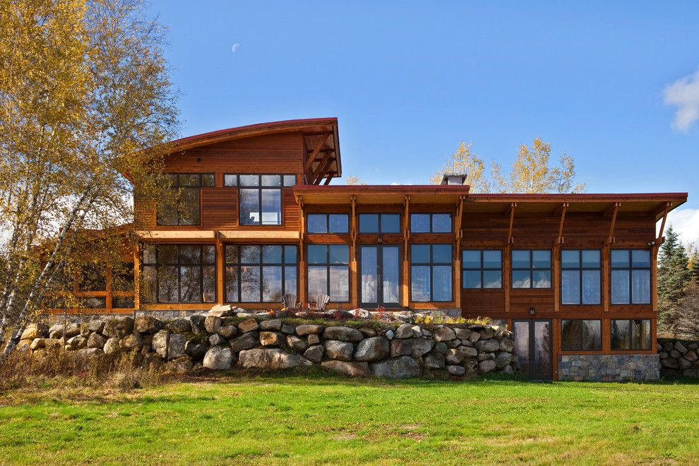 Brickman Landscaping for a Eclectic Exterior with a Exterior and Saranac Lake House by Phinney Design Group