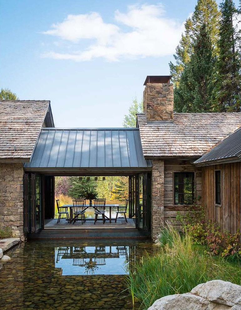 Bridger Steel for a Rustic Exterior with a Chimney Hood and Traditional Exterior by Jlfarchitects.com