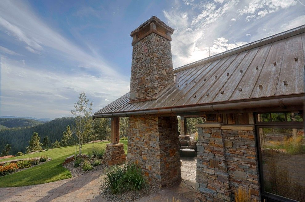 Bridger Steel for a Rustic Exterior with a Steel Roof and Rusted Steel by Bridger Steel, Inc