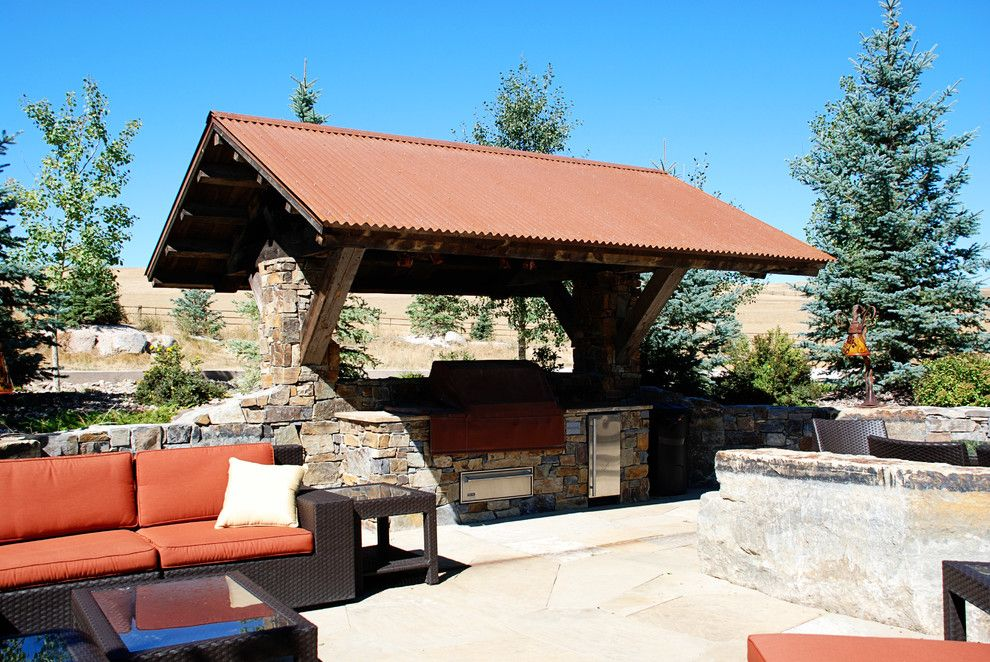 Bridger Steel for a Rustic Patio with a Corrugated and Rusted Steel by Bridger Steel, Inc