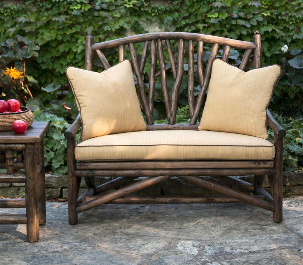 Brownstone Furniture for a Rustic Porch with a Log and La Lune Collection by La Lune Collection