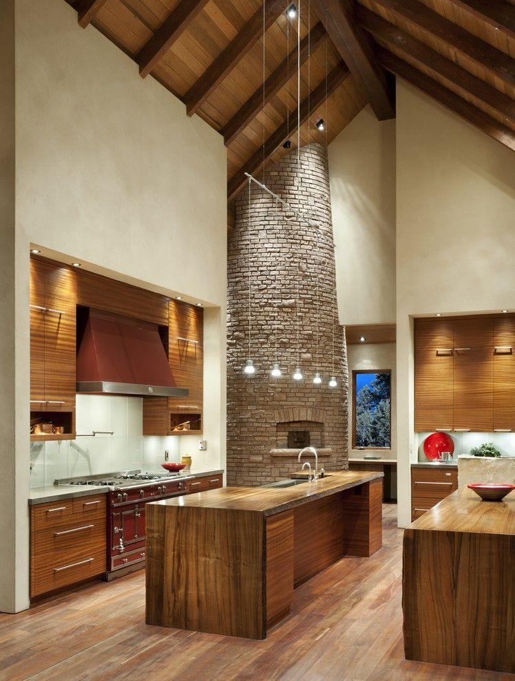 Bruck Lighting for a Contemporary Kitchen with a Exposed Beams and Whitefish Residence by Envi Interior Design Studio