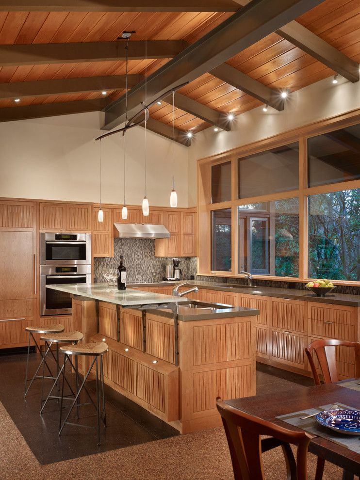 Bruck Lighting for a Midcentury Kitchen with a Metal Beam and Lake Forest Park Renovation by Finne Architects