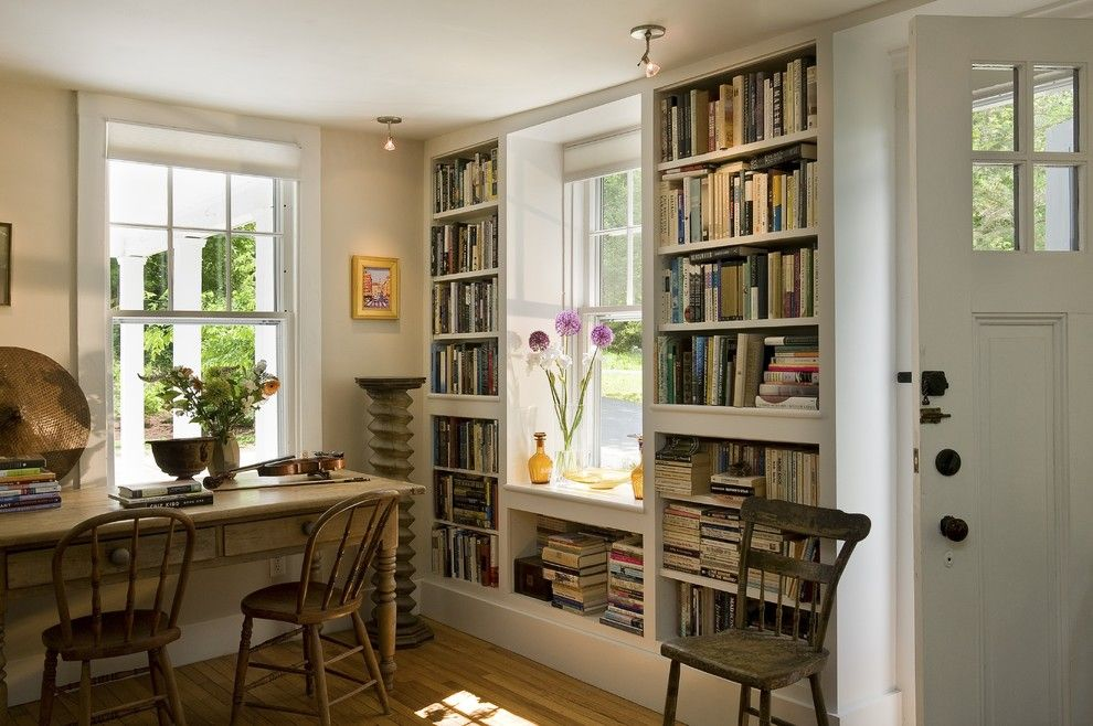 Built in Bookcase Plans for a Traditional Living Room with a Table and Bookcases Flanking Window by Smith & Vansant Architects Pc