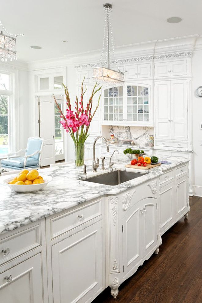 Cabinet Knob Placement for a Traditional Kitchen with a Chandelier and French Vanilla by Bradford Design Llc
