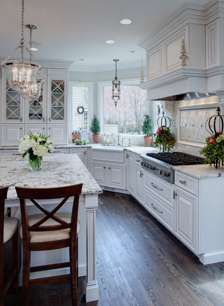 Cabinet Knob Placement for a Traditional Kitchen with a White Cabinets and Well Dressed Traditional Kitchen by Drury Design
