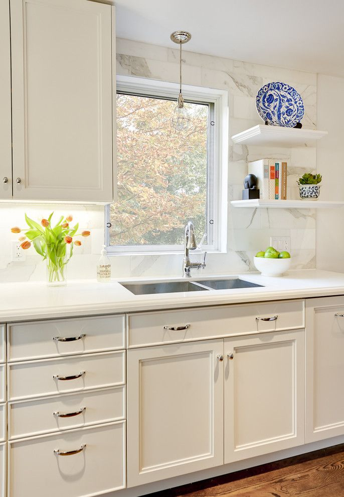 Caesarstone Colors for a Contemporary Kitchen with a Hardware and Kitchen by Leslie Goodwin Photography