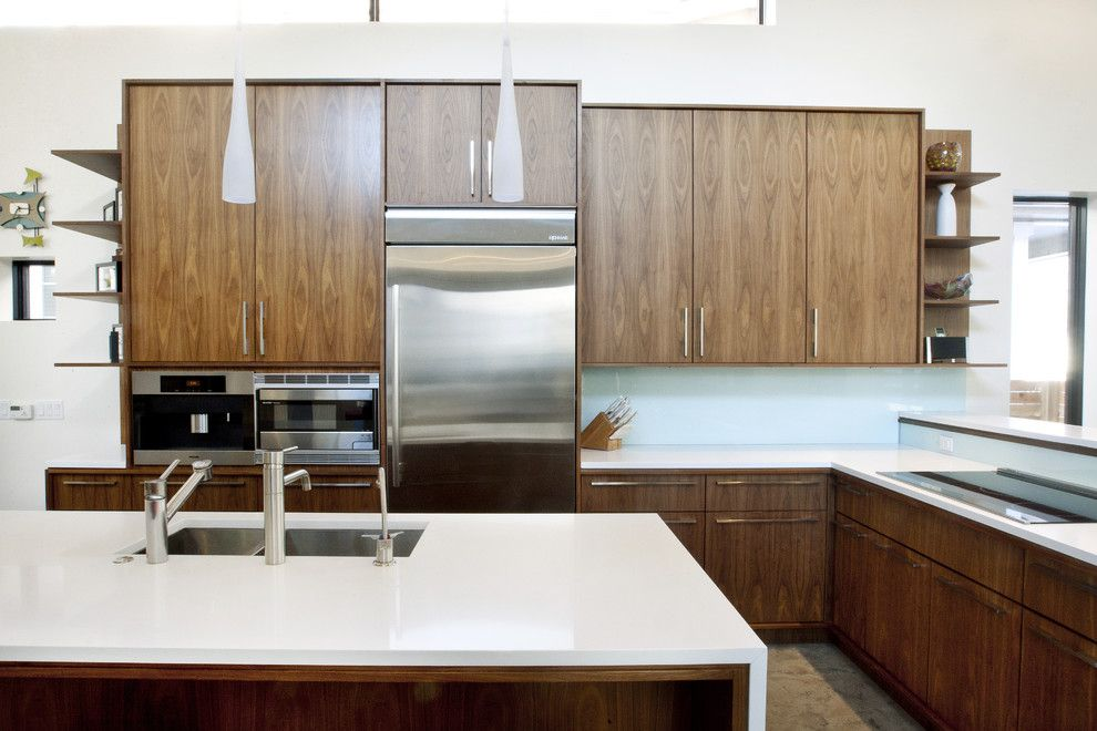 Caesarstone for a Modern Kitchen with a Waterfall Counters and Walnut and White Kitchen by Design Platform